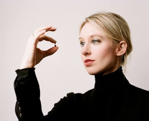 Elizabeth Holmes of Theranos holds a small sample of blood